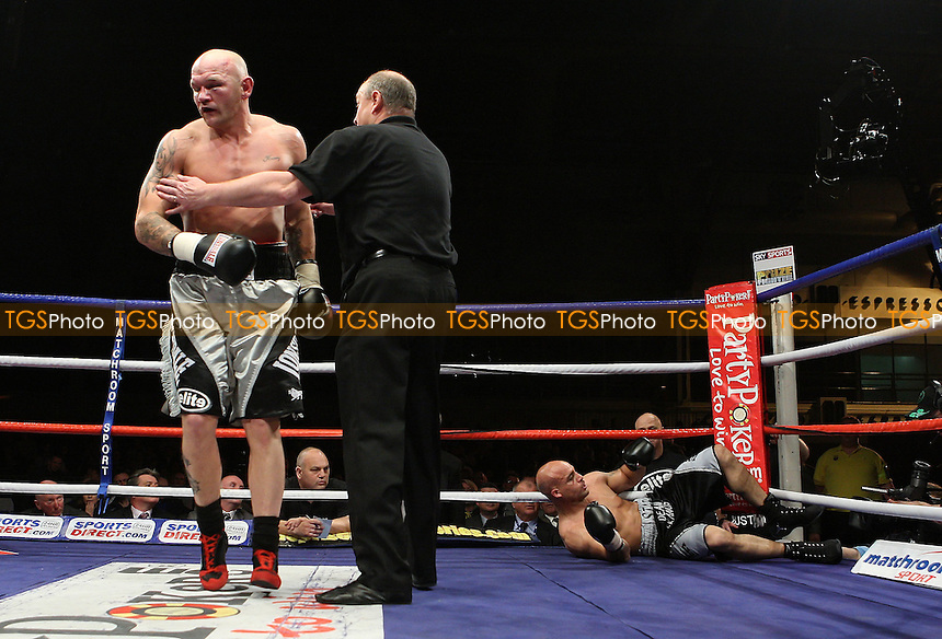 John 'Buster' Keeton (Sheffield, silver/black shorts) defeats Dean Francis (Basingstoke, black/silver shorts) - Semi-Final of Prizefighter 'The Cruiserweights' Boxing contest at Earls Court, London promoted by Barry Hearn / Matchroom Sports - 19/05/09 - MANDATORY CREDIT: Gavin Ellis/TGSPHOTO - Self billing applies where appropriate - 0845 094 6026 - contact@tgsphoto.co.uk - NO UNPAID USE.