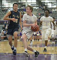 NWA Democrat-Gazette/ANDY SHUPE<br /> Fayetteville's Connor Barnett (center) drives to the lane ahead of Bentonville West's Austin Conner (35) Friday, Jan. 4, 2018, during the first half of play in Bulldog Arena. Visit nwadg.com/photos to see more photographs from the game.