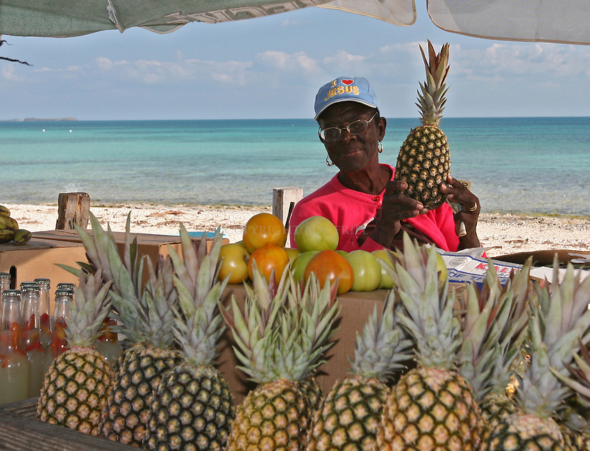 Blanch holds up one of her finest Eleutheran pineapples at her stand south of Governor's Harbour, Eleuthera, Bahamas, Out Islands