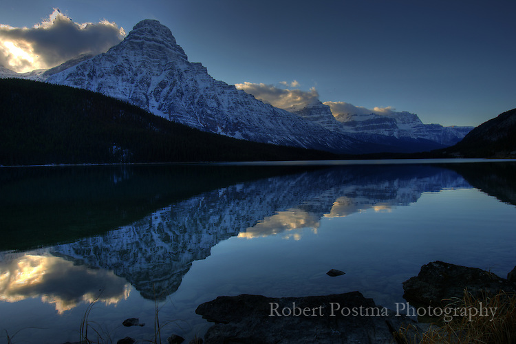 Mountain reflected into unnamed lake along Columbia Icefields Parkway, Alberta.
