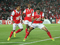 BOGOTA -COLOMBIA. 11-02-2014. Daniel Torres de Independiente Santa Fe de Colombia celebra su  gol   contra  Nacional  de Paraguay  durante el partido de ida de La Copa Bridgestone Libertadores de America   disputado en el estadio El Campin. /Daniel Torres  of Independiente Santa Fe of Colombia celebrates his goal  against Nacional of Paraguay  XXXX during firts  leg of the Copa Libertadores de America Bridgestone played at El Campin stadium . Photo: VizzorImage / Felipe Caicedo / Staff