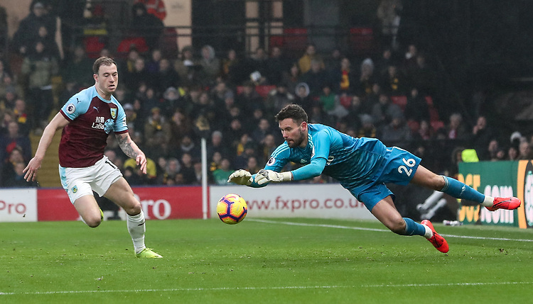 Watford's Ben Foster saves under pressure from Burnley's Ashley Barnes<br /> <br /> Photographer Andrew Kearns/CameraSport<br /> <br /> The Premier League - Watford v Burnley - Saturday 19 January 2019 - Vicarage Road - Watford<br /> <br /> World Copyright &copy; 2019 CameraSport. All rights reserved. 43 Linden Ave. Countesthorpe. Leicester. England. LE8 5PG - Tel: +44 (0) 116 277 4147 - admin@camerasport.com - www.camerasport.com