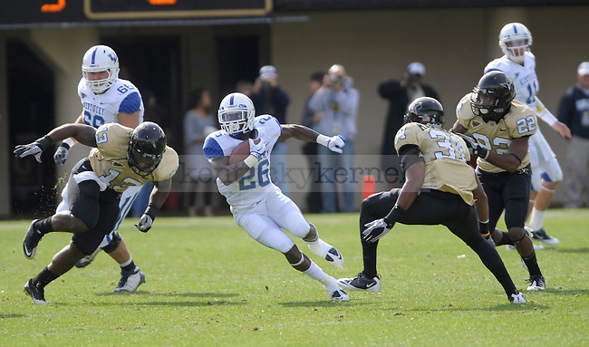 Kentucky Wildcats running back CoShik Williams (26) runs with the ball during the University of Kentucky Football game against  Vanderbilt at Vanderbilt Stadium in Nashville, Tn., on 11/12/11. Uk trailed the game at half 0-24. Photo by Mike Weaver | Staff
