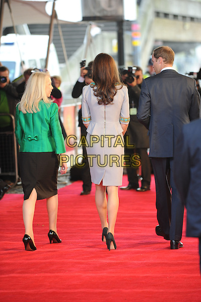Prince William, Duke of Cambridge & Catherine, Duchess of Cambridge .'African Cats' UK Premiere at BFI Southbank, London, England..25th April 2012.full length kate royals royalty married husband wife blue suit grey gray dress turquoise gold beads beaded umbrella back behind rear zip zipper.CAP/CAS.©Bob Cass/Capital Pictures.