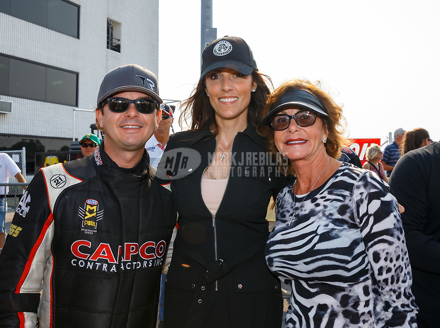 Sep 4, 2017; Clermont, IN, USA; NHRA top fuel driver Steve Torrence (left) with mother Kay Torrence (right) and Taya Kyle during the US Nationals at Lucas Oil Raceway. Mandatory Credit: Mark J. Rebilas-USA TODAY Sports