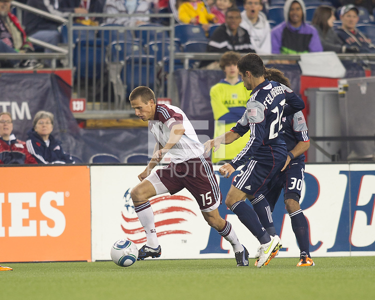 Colorado Rapids midfielder Wells Thompson (15) brings the ball forward as New England Revolution defenders close. In a Major League Soccer (MLS) match, the New England Revolution tied the Colorado Rapids, 0-0, at Gillette Stadium on May 7, 2011.