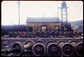 Wheels for R.R. cars in Durango yard with sand tower and sand house in background.<br /> D&amp;RGW  Durango, CO
