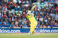 Pat Cummins (Australia) has a big heave and is caught behind by MS Dhoni (India) during India vs Australia, ICC World Cup Cricket at The Oval on 9th June 2019