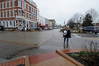 """NWA Media/ J.T. Wampler - Johnna Duncan of Bentonville crosses Central Ave. in downtown Bentonville Monday Dec. 22, 2014. Duncan works downtown and has noticed drivers attitudes change over the years. """"People expect to see pedestrians now."""" said Duncan."""