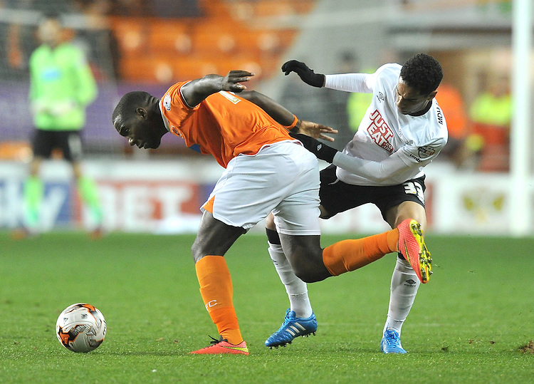 Blackpool's Ishmael Miller is tackled by Derby County's Omar Mascarell<br /> <br /> Photographer Dave Howarth/CameraSport<br /> <br /> Football - The Football League Sky Bet Championship - Blackpool v Derby County - Tuesday 21st October 2014 - Bloomfield Road - Blackpool<br /> <br /> &copy; CameraSport - 43 Linden Ave. Countesthorpe. Leicester. England. LE8 5PG - Tel: +44 (0) 116 277 4147 - admin@camerasport.com - www.camerasport.com