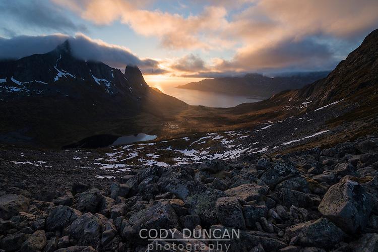 Midnight sun over Kongen mountain peaks and Øyfjord, Senja, Norway