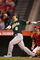 Kurt Suzuki #8 of the Oakland Athletics bats against the Los Angeles Angels at Angel Stadium on April 19, 2012 in Anaheim,California. Oakland defeated Los Angeles 4-2.(Larry Goren/Four Seam Images)
