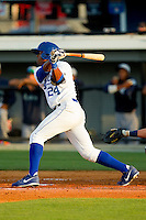 Alex Newman (24) of the Burlington Royals follows through on his swing against the Pulaski Mariners at Burlington Athletic Park on June20 2013 in Burlington, North Carolina.  The Royals defeated the Mariners 2-1 in 13 innings.  (Brian Westerholt/Four Seam Images)