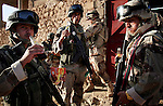 Iraqi soldiers take a soda break as they and the Marines of Kilo Co. 3rd Battalion 1st Marines (3/1) carry out a cordon and search looking for insurgents, weapons, and explosive devices in the eastern districts of the al-Anbar Province city of Hit, Iraq on Tues. Sept. 20, 2005.