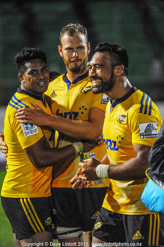 Julian Savea (left), James Broadhurst and Victor Vito celebrate after the final whistle of the Super Rugby match between the Hurricanes and Blues at FMG Stadium, Palmerston North, New Zealand on Friday, 13 March 2015. Photo: Dave Lintott / lintottphoto.co.nz