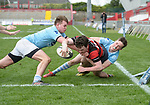 Niall O Brien of Ennis  in action against Jack Hennessy and Evan Griffin of Garryowen during their U-18 Munster Club Final at Thomond Park. Photograph by John Kelly.