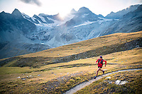 Trail running at sunset above Zermatt, Switzerland with the Obergabelhorn in the distance.