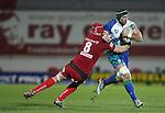 Scarlets number 8 Kieran Murphy tackles John Muldoon..Scarlets v Connacht.Parc y Scarlets.Rabo Pro12.08.02.13.©Steve Pope-SPORTINGWALES