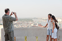 Tourists take photos with the city in the backgorund on summer sightseeing in Budapest, Hungary on August 25, 2011. ATTILA VOLGYI
