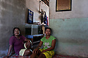 Indonesia - Bangka Island - Batako - Nurajya Makaraka, 45 from Sulawesi Island and Sumrya Rohmani, 38, from Madura Island  sitting in the apartement they share with 5 other miners. Both of them have left their islands in order to become miners in Bangka.