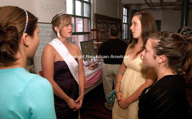 WINSTED, CT 04 JUNE, 2010-060410JS01- 2009 LAurel Queen Maggi Muirhead, second from left, talks with friends, from left, Chloe Nanni of Barkhamested, Becca Nardi of Barkhamsted and Kristen Dombrowski of New Hartford  during the opening reception for the 76th annual Laurel Festival Friday night at Whiting Mills in Winsted. The artist studios at Whiting Mills will be open to the public on Saturday and Sunday from 1-5 p.m with the Laurel Festival next weekend, June 11-13.<br /> Jim Shannon Republican-American