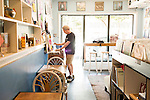 May 8, 2015. Carrboro, North Carolina.<br />  Gary Poole, a Chapel Hill resident, browses the new arrivals at Vinyl Perk. Poole regularly buys and trades records at the store.<br />  Vinyl Perk opened almost 2 years ago and specializes in vinyl records of many genres and  pour over coffee.<br />  Outsiders tend to lump Chapel Hill with nearby Durham, but the more sensible pairing is with Carrboro, the adjacent town that was once a mere offshoot known as West End. Even today the transition from Chapel Hill, anchored by North Carolina''s flagship public university, into downtown Carrboro is virtually seamless.