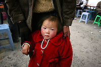 CHINA. Chongqing Province.  A young girl in the town of Wushan, which lies on the banks of the Yangtze and at the entrance to the 3 Gorges.  The flooding of the three Gorges, by damming the Yangtze near the town of YiChang, has remained a controversial subject due to the negative environmental consequences and the displacement of millions of people in the flood plain. The Yangtze River however is reported to be at its lowest level in 150 years as a result of a country-wide drought. It is China's longest river and the third longest in the world. Originating in Tibet, the river flows for 3,964 miles (6,380km) through central China into the East China Sea at Shanghai.  2008.