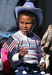 Airel Young, 7, of Fallon, watches the annual Veterans Day parade in Virginia City, Nev., on Wednesday, Nov. 11, 2015. <br /> Photo by Cathleen Allison