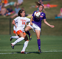 Danielle Colaprico (24) of Virginia fights for the ball with Gabby Byorth (27) of Clemson at Klockner Stadium in Charlottesville, VA.  Virginia defeated Clemson, 3-0.