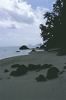Looking along a beach on the far north east coast of Mahe in the late afternoon shade.