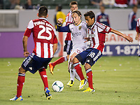 CARSON, CA - May 19, 2012: Real Salt Lake midfielder Ned Grabavoy (20) and Chivas USA midfielder Martin Ponce (18) during the Chivas USA vs Real Salt Lake match at the Home Depot Center in Carson, California. Final score, Chivas USA 1, Real Salt Lake 4.