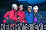 Denis Walsh, 56, Norfolk, England and his son Richard, 30, share a joke with Kerry Mountain Team members John O'Sullivan and Gerry Christie after their rescue by the team from the Carrauntuohill-Caher ridge on Monday night.....
