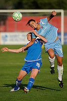 Yael Averbuch (10) of Sky Blue FC heads the ball over Kelly Smith (10) of the Boston Breakers. Sky Blue FC defeated the Boston Breakers 2-1 during a Women's Professional Soccer match at Yurcak Field in Piscataway, NJ, on May 31, 2009.