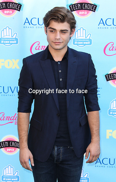 UNIVERSAL CITY, CA - AUGUST 11: Garrett Clayton arrives at the 2013 Teen Choice Awards held at Gibson Amphitheatre on August 11, 2013 in Universal City, California. Credit: MediaPunch Inc.<br />