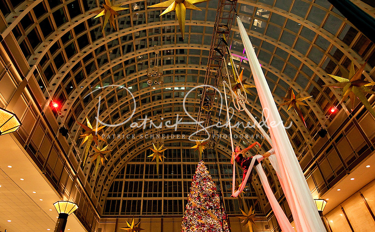 Caroline Calouche & Co. present a blend of aerial and contemporary dance before New Year's Eve revelers in Wachovia-Wells Fargo Atrium during First Night Charlotte 2010. The aerial performers wowed crowds during the family-friendly public event (no alcohol allowed) is an annual cultural New Year's Eve celebration held in downtown / uptown / Charlotte center city. Charlotte First Night - An Imagination Celebration brought together artists, musicians, dancers and more from across the country. The New Year's event is organized by Charlotte Center City Partners, which facilitates and promotes the economic and cultural development of this North Carolina urban core.