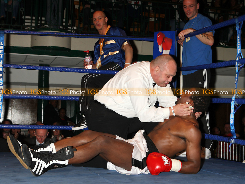 John Wayne Hibbert (white/blue shorts) defeats Bheki Moyo in a boxing contest at York Hall, Bethnal Green, promoted by Left Jab / Miranda Carter - 06/12/09 - MANDATORY CREDIT: Gavin Ellis/TGSPHOTO - Self billing applies where appropriate - Tel: 0845 094 6026