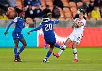 HOUSTON, TX - JANUARY 28: Kethna Louis #20 clears the ball past Carli Lloyd #10 of the United States during a game between Haiti and USWNT at BBVA Stadium on January 28, 2020 in Houston, Texas.