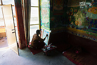 A Bon monk draws Buddhist thangkas at Yong Zhong Lin Monastery in Xigaze, Tibet, China, 2015. The original Bon (Yungdrung Bon) was founded around 16,000 BC,  according to the followers who are called Bonpo. Today, Bon can be found in the more isolated parts of northern and western Tibet. According to the Chinese census, about 10% of Tibetans (about 100,000 people) follow Bon.
