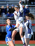 (Brockton MA 11/14/15)  Medway Shannon Aviza, up in the air takes the ball of her body, with her is teammate 8, Meghan Foley and Dover-Sherborn 30, Molly Doyle, during the division three south girls soccer final, Saturday, November 14, 2015, at Brockton High School. Herald Photo by Jim Michaud