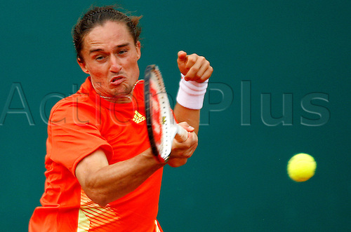 19.04.2012 Monte Carlo, Monaco. Alexandr Dolgopolov (UKR) in action against Novak Djokovic (SRB) during the 3rd Round of the 2012 Monte-Carlo Rolex Masters tennis played at the Monte Carlo Country Club, Monaco.