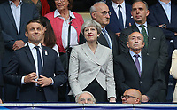 British Prime Minister Theresa May (Centre) stands alongside French President Emmanuel Macrois (left) in attendance during the International Friendly match between France and England at Stade de France, Paris, France on 13 June 2017. Photo by David Horn/PRiME Media Images.