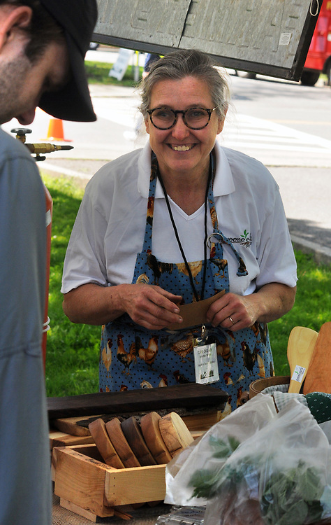 Diane Carlson serving customers at the Greene Earth Farm Booth at the Opening Day of the 2017 Saugerties Farmer's Market on Saturday, May 27, 2017. Photo by Jim Peppler. Copyright/Jim Peppler-2017.