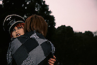 A cos-play girl or Harajuku cos player girl in a Nazi military uniform hugs another cosplayer. Harajuku, Tokyo, Japan September 2005