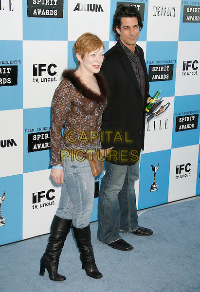 FRANCIS FISHER & GUEST.The 2007 Independent Spirit Awards held at the Santa Monica Pier, Santa Monica, California, USA..February 24th, 2007.full length frances jeans denim tucked into black boots brown floral print fur trim top .CAP/ADM/RE.©Russ Elliot/AdMedia/Capital Pictures