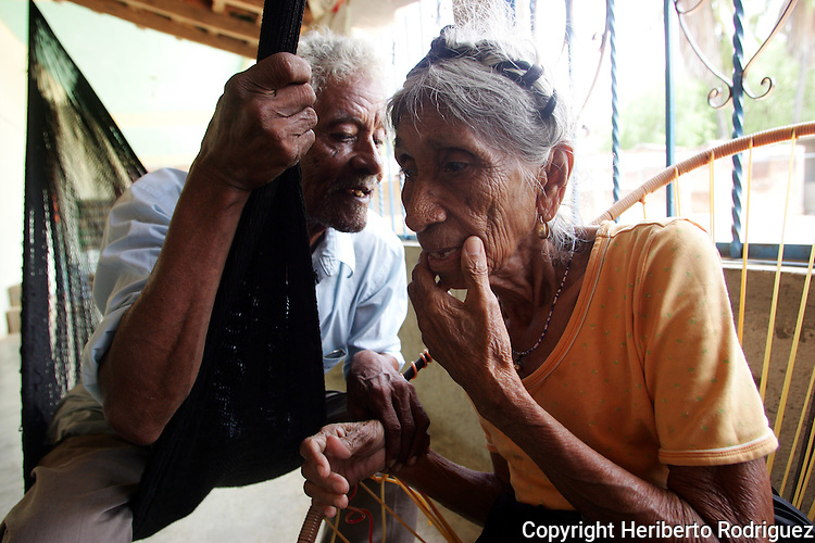 Don Melquiades Dominguez, 82, talks with Dona Catalina Noyola Bruno (85) in her home in San Nicolas village, in the Costa Chica of southern Guerrero state, July 6, 2005. Dominguez and Noyola lead efforts to preserve traditional customs, besides, they narrate and sing for dances at the annual festivals in their AfroMexican village. Photo by Heriberto Rodriguez