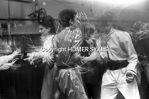 "Blitz Kids New Romantics at The Blitz Club Covent Garden, London, England 1980. Julia Fodor (Princess Julia) and a couple of ""Space Cadets"" dancing the night away. Stephen Jones the milliner is centre back view.<br />