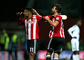 2nd December 2017, Griffen Park, Brentford, London; EFL Championship football, Brentford versus Fulham; Ollie Watkins of Brentford shoots celebrates with Yoann Barbet of Brentford towards the Brentford fans after scoring his sides 3rd goal in the 84th minute to make it 3-1