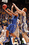 SIOUX FALLS, SD - MARCH 11:  Pierre Bland #2 from IPFW takes the ball to the basket between Brayden Carlson #12 and Tony Fiegen #34 from South Dakota State University in the second half of their semifinal game Monday night at the Summit League Basketball Tournament in Sioux Falls, SD.  (Photo by Dave Eggen/Inertia)