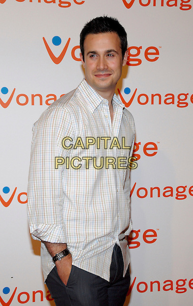FREDDIE PRINZE JR..Vonage introduces the new V-Phone during a party at Aer Lounge, New York, NY, 28 June 2006.  .half length white shirt hands in pockets 3/4.Ref: ADM/PH.www.capitalpictures.com.sales@capitalpictures.com.©Paul Hawthorne/AdMedia/Capital Pictures.
