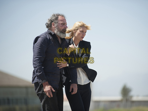 Homeland (2011-)<br /> (Season 4)<br /> Mandy Patinkin as Saul Berenson and Claire Danes as Carrie Mathison<br /> *Filmstill - Editorial Use Only*<br /> CAP/FB<br /> Image supplied by Capital Pictures